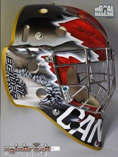 Yesterday InGoal presented the mask Geneviève Lacasse will be taking to Sochi for the Olympic Winter Games, and today we are pleased to offer the first look at her Canadian teammate Charline Labonté's design from Sylvie Marsolais of Sylabrush.com. Like her teammate, Labonté went with a black base on her mask for this striking design which is equal parts bold design and subtle details.
