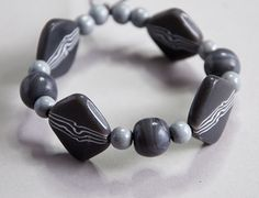 Making polymer clay beads with an organic wavy pattern.