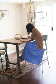 Love that table. At Home With Danni Hong via A Beautiful Mess