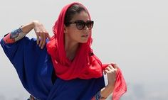 A model wearing an Iranian-style manteaux and scarf. http://iranfashion.com/