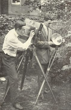 mpdrolet: Percy Smith was probably Charles Urban's most noted cameraman. His speciality was films of natural history, and he developed pioneering stop-motion photography techniques to film such natural activities as plant growth. In this photograph, Smith (on the left) is seen filming in his garden in Southgate, London. After leaving Urban's employment, Smith would gain much acclaim for his Secrets of Nature film series of the 1920s and 1930s.