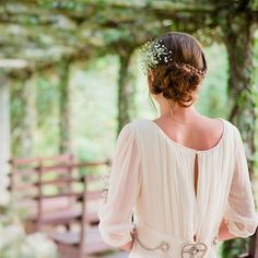 Brides.com: 14 Wedding Hairstyles for Curly Hair. A Wedding Hairstyle with a Bohemian Braided Bun. Baby's breath paired with a gauzy, ethereal gown makes for a romantic, bohemian look. We love the intricate, twisted bun surrounded by a thin braid.  Browse more wedding updos.