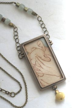 He Holds This Tiny Being Closely ..hand pulled print in hand crafted jewelry. emenlu.com