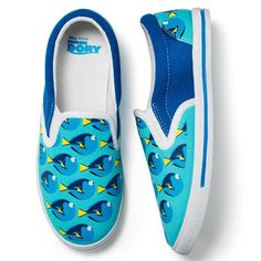 Blue and white Finding Dory themed kids' slip-on sneakers..Canvas, Upper and back counter has light blue background with Dory print pattern- Sides have solid dark blue- Easy on/offWhile supplies last. Shop online at www.youravon.com/my1724 or by clicking on the pin!!