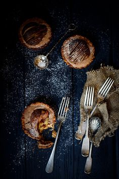 Chocolate tarts with almond pears