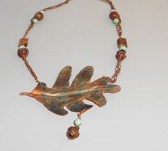 "The Sumac Collection  Jewelry form folded copper oak leaf, pearl ""acorn"" with natural acorn top, turquoise, agate"