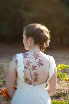 I love this dress and her tattoo! from: One wedding to rule them all: a Lord of the Rings fantasy | Offbeat Bride