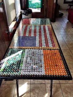 DIY beer pong table. Collect beer caps and design your own!