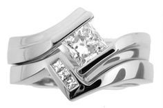 Contemporary tension set Wedding Rings for Women | It has like a modern feel...kinda cool | Diamonds ARE a girls best fr ...