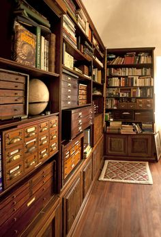 """cabinet/library GF  December 06 2013"" -- SH: I haven't been able to track this further back than this click-through; I don't know what the caption means, but I could definitely live happily in this room with the multiple card catalogs and card-catalog-like furnishings!"