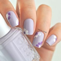 Beautiful nail art, lavender with little flowers.