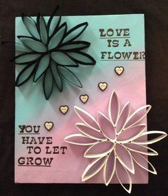 DIY Flower Quote Canvas! Materials: Stretched Canvas, Toilet or Paper Towel Rolls, Apple Barrel Acrylic Paint in Black, Pool Blue, and Lilac Mist, Folk Art Acrylic Paint in White, Hot Glue, Ink Pen, Heart Buttons from Michaels, and Letter Stencil. 1. Glue together flowers (many tutorials on Youtube). 2. Paint one black and one white (or any other colors). 3. Paint canvas in desired way (I did a fade). 4. Glue flowers to Canvas. 5. Stencil out desired quote. 6. Glue down hearts etc. Have Fun!