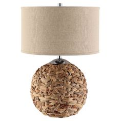 Orb-shaped table lamp with a woven rattan design and drum shade.  Product: Table lampConstruction Material: Rattan an...