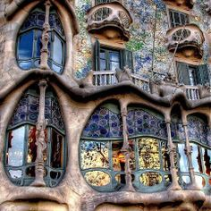 Casa Batlló,built in the year 1877 remodeled in the years 1904–1906; located at 43, Passeig de Gràcia in the Eixample district of Barcelona,Spain.The local name for the building is Casa dels ossos (House of Bones)as it has a visceral, skeletal quality.    The building is very remarkable,identifiable as Modernisme or Art Nouveau in the broadest sense. The ground floor in particular, is rather astonishing with tracery, irregular oval windows and flowing sculpted stone work.