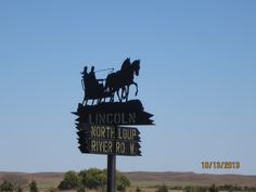 Lincoln and North Loup River Road West street sign in Brewster, Nebraska.