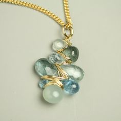 Aquamarine Necklace Gem Weave Pendant Wire Wrapped by Fuss Jewelry. $162.00, via Etsy.