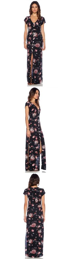 Faithfull The Brand. Black Calypso Maxi Dress. 100% rayon. Hand wash cold. Unlined. Decorative front buttons. Front slit. Hidden center back zipper closure. Modeled in size S. Shoulder seam to hem measures approx 147 cm in length. Color: Nightingale Print