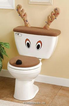 Okay so this site is not in english, but I think they just bought brown toilet covers, a nose, homemade eyes and cut antlers off a headband. Really awesome