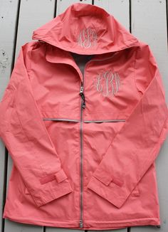 Monogrammed Rain Jacket. Wouldn't mind rainy days as much if I had this. Maybe a different color monogram though.