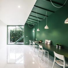Splashes of green are used throughout this Thai TV production office in Bangkok, revamped by Thai firm Anonymstudio.