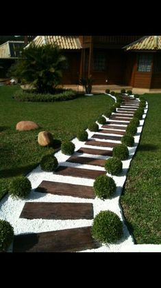 31 Great Front Walkway Ideas You Will Want To Implement Now!- 31 Great Front Walkway Ideas You Will Want To Implement Now! for 2019 – A Nest With A Yard Grass and shrubs create the perfect border to a walkway made of pallet wood and white pebbles - Small Front Yard Landscaping, Garden Landscaping, Backyard Walkway, Front Yard Walkway, Pallet Landscaping Ideas, Backyard Ideas, Landscaping Small Backyards, Wooded Backyard Landscape, Railroad Ties Landscaping