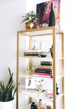 If you're like me and decorating on a budget, but still need really nice looking things, a quick DIY project can spruce up the most basic furniture pieces, or dress up a bare wall. Here are a few things I did in my small apartment that didn't take too much time or money, but really helped glam up the space. SHELF AND DESK UPGRADE What you'll need: Gold spray paint I started with the Ikea Vittsjo shelf in white. (When I got it, it actually came with these white shelves, though it look...