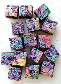 "Galaxy Brownies feature swirls of colorful blondie with star speckled, fudgy brownie. Appropriately, this chewy, chocolate deliciousness is ""out of this world""!