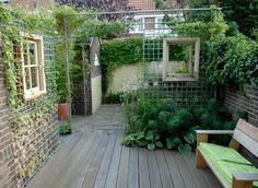 "Windows set in mesh ""wall"" heightens the effect of a ""garden room"""