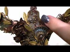 Steampunked Dressform using Tim Holtz Distress Paints, Watch Parts and Starbursts