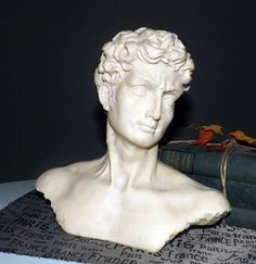 Hand-crafted bust  sculpture of a male head. Greco Roman