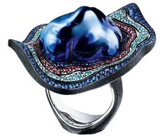 This unusual ring by Jewellery Theatre features a spectacular baroque tanzanite.