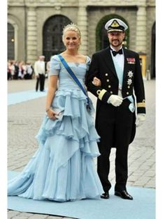 Crown Princess Mette-Marit of Norway and Crown Prince Haakon - too much froo-froo and yuk on the dress! Less around the waist and hips would do her much better!