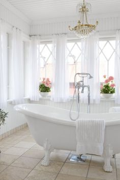 In a room of white and pastels, don't be afraid to splash out on one bold element; in this case, a claw-foot bathtub.