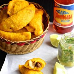 Colombia: These wonderful empanadas are one of the most popular Colombian snacks. The crust is made with corn masa while the filling is made with meat, potatoes and spices. It's traditional to serve these empanadas with ají (Colombian-style hot sauce) Colombian Dishes, Colombian Cuisine, My Colombian Recipes, Empanada Recipe Colombian, Comida Latina, Tapas, Columbian Recipes, Tandoori Masala, Latin Food