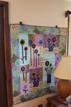 very sweet-the flowers could be wool Blogger's Quilt Festival - Applique Category