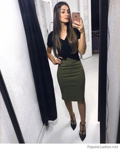 Black top and pumps with olive skirt