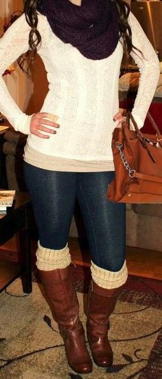 dark blue jeggings, white/ivory fitted sweater, dark brown wool infinity scarf, light brown boots with matching hand bag, and white/ivory wool boot socks.