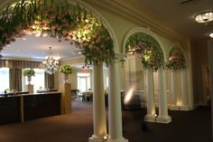 Arches of suspended tulips by Garden District Memphis