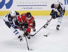 Kamil Krzaczynski / The Associated Press</p><p>Winnipeg Jets' defenceman Dustin Byfuglien (33) battles for the puck against Chicago Blackhawks' right wing Patri...