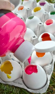 Fill eggs with paint and toss them at canvas! This project is surprisingly easy to set up and SO FUN! Boredom Buster?
