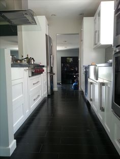 TILE flooring that looks like wood flooring. Remodel by LA based remodeling company State Wide Construction and Remodeling. Http://www.swhomeremodeling.com