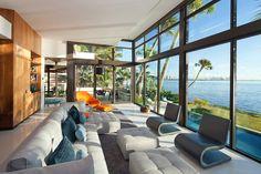 Архитекторы Touzet Studio представили проект частной резиденции Coral Gables, расположенной в пригороде Майами, Флорида, США. Особняк выполнен в современном стиле, а его площадь составляет 6,091 кв. метров. Построенный прямо на побережье, он отличается глухим фасадом со стороны дороги, не позволя...