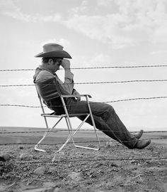 James Dean taking a brake on the set of 'Giant', 1955,  photographed by Frank Worth.