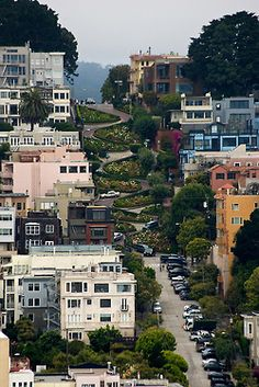 Destination #14: Lombard Street in San Fransisco, CA.  Trolly rides, sea food, Ghirardelli  chocolate sundaes, driving up steep inclines, cold breezes...ahhh...there is nothing quite like San Fran.