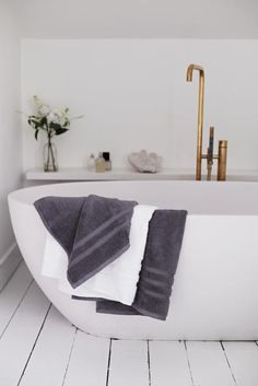 Keep it classic with grey and white towels.