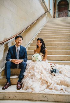Bride and Groom with Puppy in Vest Ways to Include Your Pet in the Wedding | Brides.com