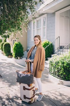 Gal Meets Glam Travel Style - Nike sneakers, Goyard Tote bag and Steamline Luggage carry-on