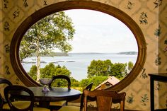 View through the window of the Roosevelt Cottage on Campobello Island, Canada looking toward Eastport, ME and overlooking the Salmon Farms.