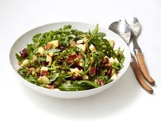 Arugula with Apples and Walnuts : For an easy, creamy dressing for peppery arugula, whisk together Greek yogurt, olive oil and lemon juice.