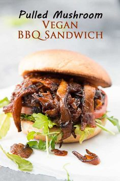 Pulled Shiitake Mushroom Vegan BBQ Sandwich! It has the perfect meaty and chewy texture, is dripping with thick and sticky BBQ sauce, and is a great quick and easy meal to whip up for a crowd! #veganrecipes #vegansandwich #bbqsandwich #veganbbq